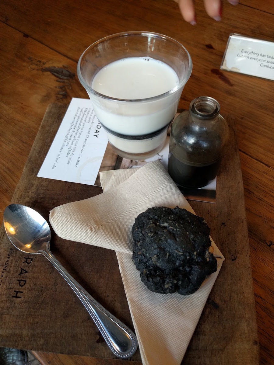 Charcoal activated coffee over panna cotta with charcoal chocolate cookie
